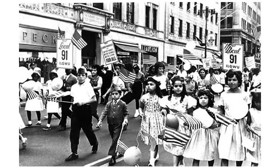 """Children march in the 1963 New York City Labor Day parade. Since the very first celebration, Labor Day has been a time for families to relax and have fun."""